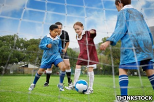 Youngsters playing football